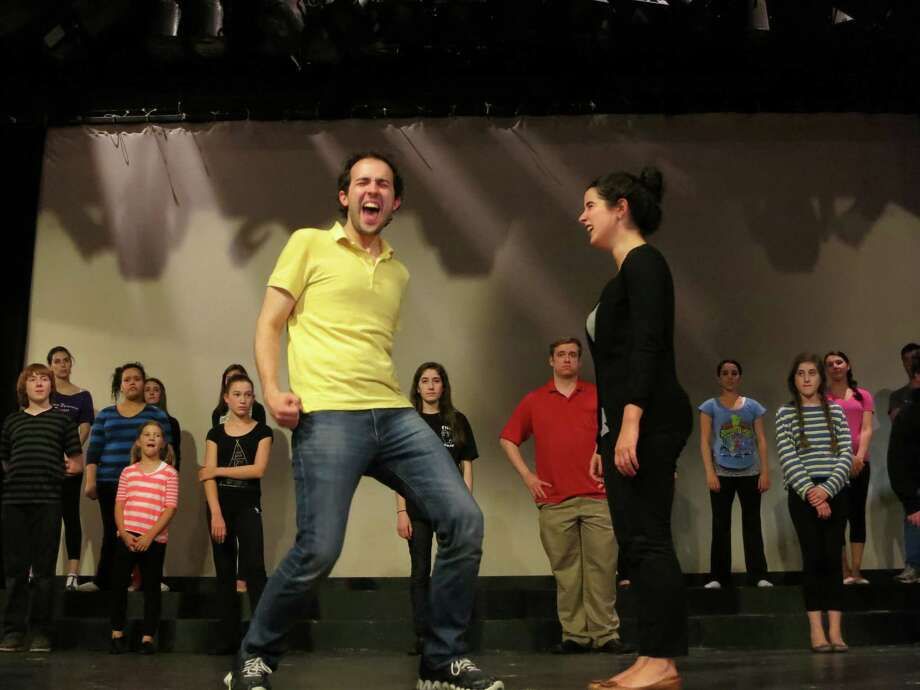 "John Stegmaier (center left) and Laura Piacenza rehearse with the company of ""The Wedding Singer,"" which is being presented by the Bridgeport Theatre Company from May 24 to June 9. Photo: Contributed Photo"