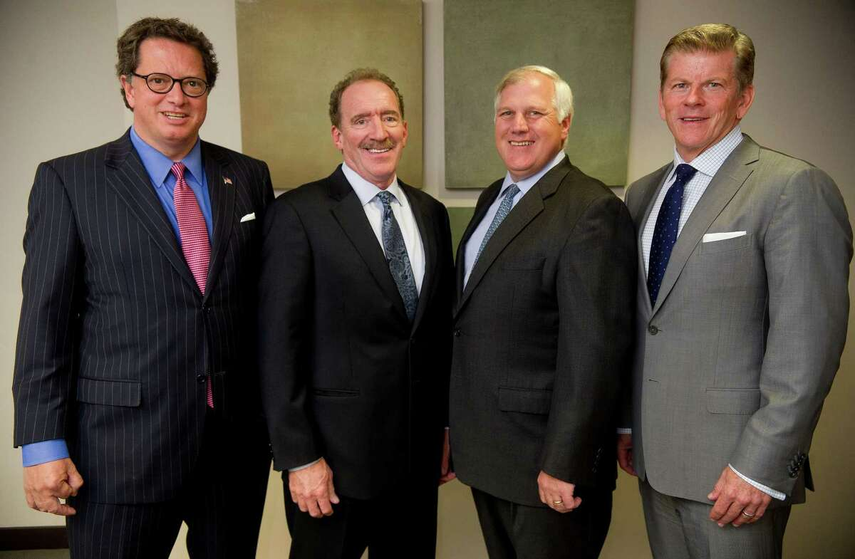Partners at LLBH Private Wealth Management, from left, Kevin Burns, Jim Pratt-Heaney, Bill Lomas and Bill Loftus pose for a photo at their Westport office on Thursday, May 16, 2013.