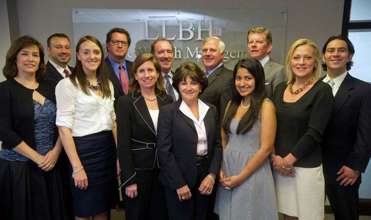 Staff members at LLBH Private Wealth Management pose for a photo at their Westport office on Thursday, May 16, 2013.