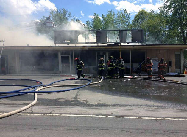 Firefighters respond to a Thursday afternoon blaze at Handy Andy's grocery store on Watervliet Shaker Road in Colonie, N.Y. (John Carl D?Annibale/Times Union)
