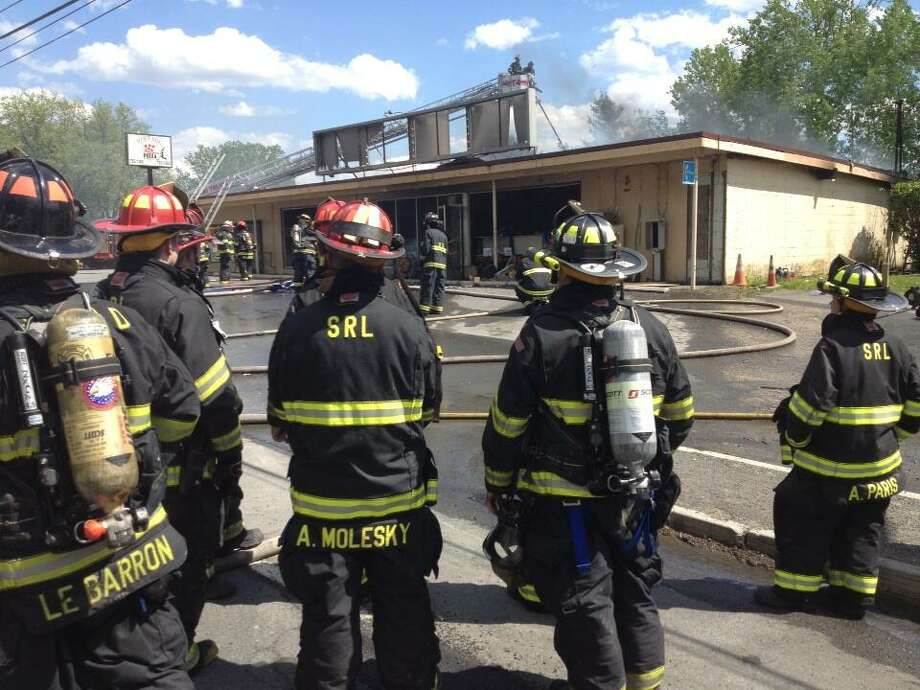 Firefighters at fire scene at Handy Andy and Vintage Pizza on Route 155 in Colonie on Thursday, May 16, 2013. (John Carl D'Annibale/Times Union)