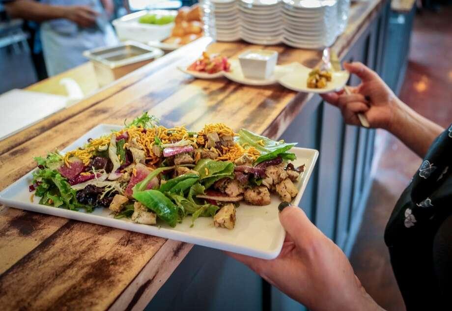 The Navi Mumbai Chicken Salad being taken to a table.