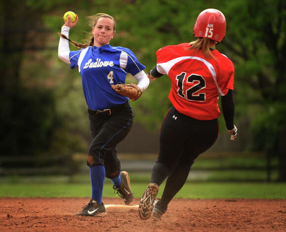 Ludlowe second baseman Alice Nelson turns the double play during their matchup with New Canaan in Fairfield, Conn. on Monday, May 13, 2013. Photo: Brian A. Pounds / Connecticut Post