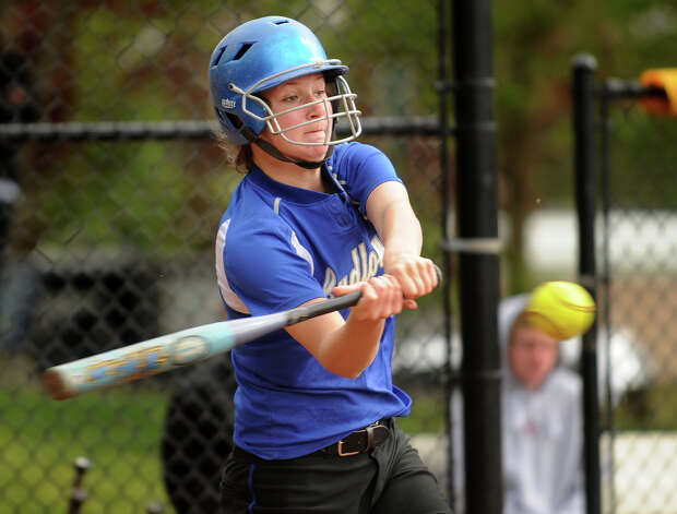 Ludlowe's Emily Nelson looks to drive the ball during their matchup with New Canaan in Fairfield, Conn. on Monday, May 13, 2013. Photo: Brian A. Pounds / Connecticut Post