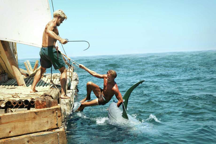 "Jakob Oftebro, left, as Torstein and Tobias Santelmann as Knut encounter a shark during their travels in ""Kon-Tiki."" Photo: Carl Christian Raabe, Handout / ONLINE_YES"