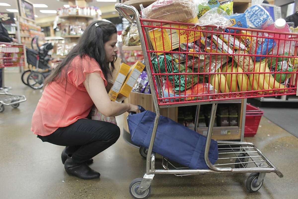 Irma Barragan picks up food from Trader Joes in Santa Rosa, Calif. on Saturday, April 13 2013. The trip from her home in Mendocino to Santa Rosa will often take eight hours so she only goes once every three weeks.