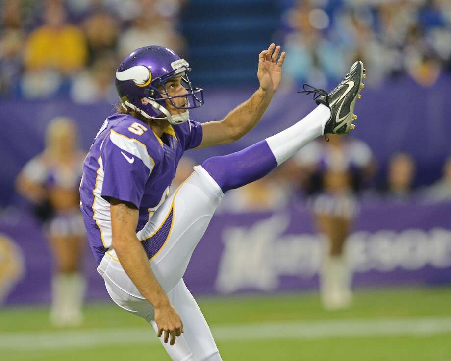 Chris Kluwe #5 of the Minnesota Vikings punts during an NFL game against the San Diego Chargers at Mall of America Field at the Hubert H. Humphrey Metrodome on August 24, 2012 in Minneapolis, Minnesota.