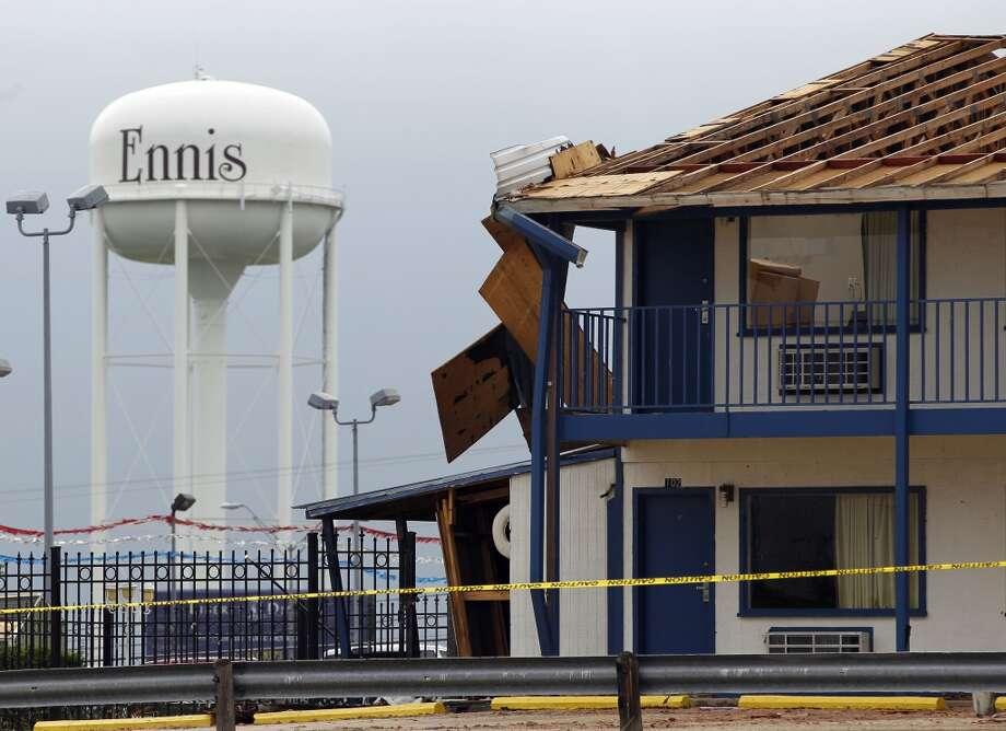 The Ennis Inn is roped off as the roof was  damaged from a passing tornado Wednesday night in Ennis, Texas on Thursday, May 16, 2013.  Forecasters say the tornado that claimed six lives and destroyed dozens of homes in northern Texas is believed to have had winds up to 200 mph (320 kph). Murphy's room is right where the tree landed.  (AP Photo/The Dallas Morning News, Vernon Bryant)  MANDATORY CREDIT; MAGS OUT; TV OUT; INTERNET USE BY AP MEMBERS ONLY; NO SALES