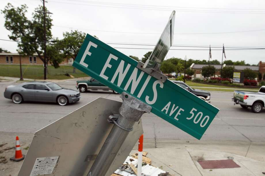 A sign is bent eastward along Ennis Ave. in Ennis, Texas  on Thursday, May 16, 2013.   Forecasters say the tornado that claimed six lives and destroyed dozens of homes in northern Texas is believed to have had winds up to 200 mph (320 kph). Murphy's room is right where the tree landed.  (AP Photo/The Dallas Morning News, Vernon Bryant)  MANDATORY CREDIT; MAGS OUT; TV OUT; INTERNET USE BY AP MEMBERS ONLY; NO SALES