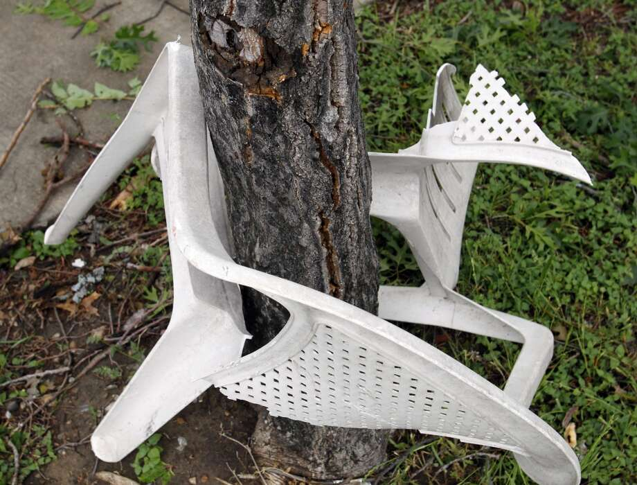 A plastic chair is wrapped around a tree in Ennis, Texas on Thursday, May 16, 2013.  Forecasters say the tornado that claimed six lives and destroyed dozens of homes in northern Texas is believed to have had winds up to 200 mph (320 kph). Murphy's room is right where the tree landed.  (AP Photo/The Dallas Morning News, Vernon Bryant)  MANDATORY CREDIT; MAGS OUT; TV OUT; INTERNET USE BY AP MEMBERS ONLY; NO SALES