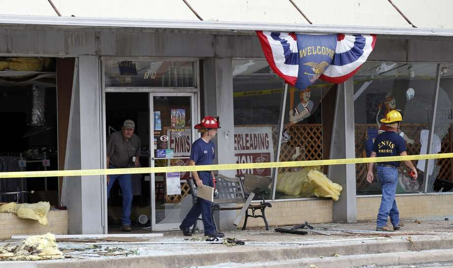 Ennis Firefighters survey damage in downtown Ennis, Texas on Thursday, May 16, 2013.   Forecasters say the tornado that claimed six lives and destroyed dozens of homes in northern Texas is believed to have had winds up to 200 mph (320 kph). Murphy's room is right where the tree landed.  (AP Photo/The Dallas Morning News, Vernon Bryant)  MANDATORY CREDIT; MAGS OUT; TV OUT; INTERNET USE BY AP MEMBERS ONLY; NO SALES