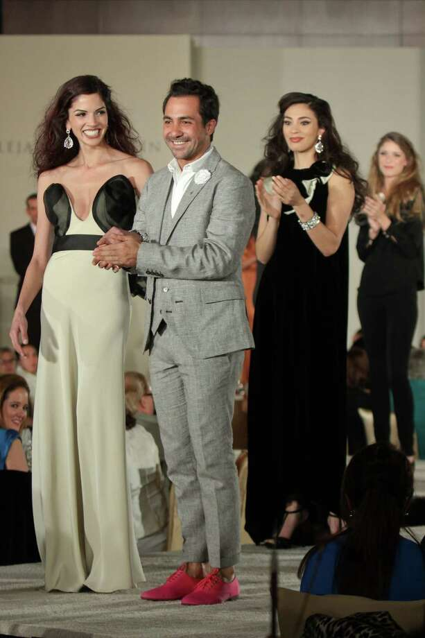 (For the Chronicle/Gary Fountain, May 3, 2013) Alejandro Carlin with models after the show featuring his fashions at the Latin Women's Initiative luncheon and fashion show. Photo: Gary Fountain, Freelance / Copyright 2013 Gary Fountain