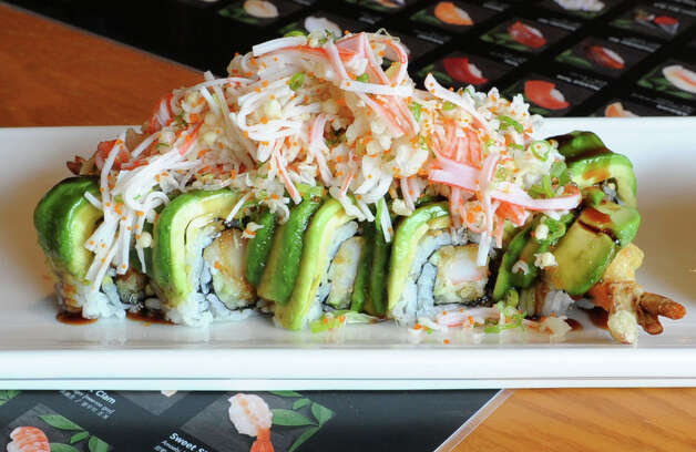 Hazel roll at Sushi Na Ra on Friday, May 10, 2013 in Clifton Park, N.Y. This roll is made with shrimp tempura, cucumber covered with avocado tempura flakes, crab, scallion and masago on top. (Lori Van Buren / Times Union) Photo: Lori Van Buren / 00022360A