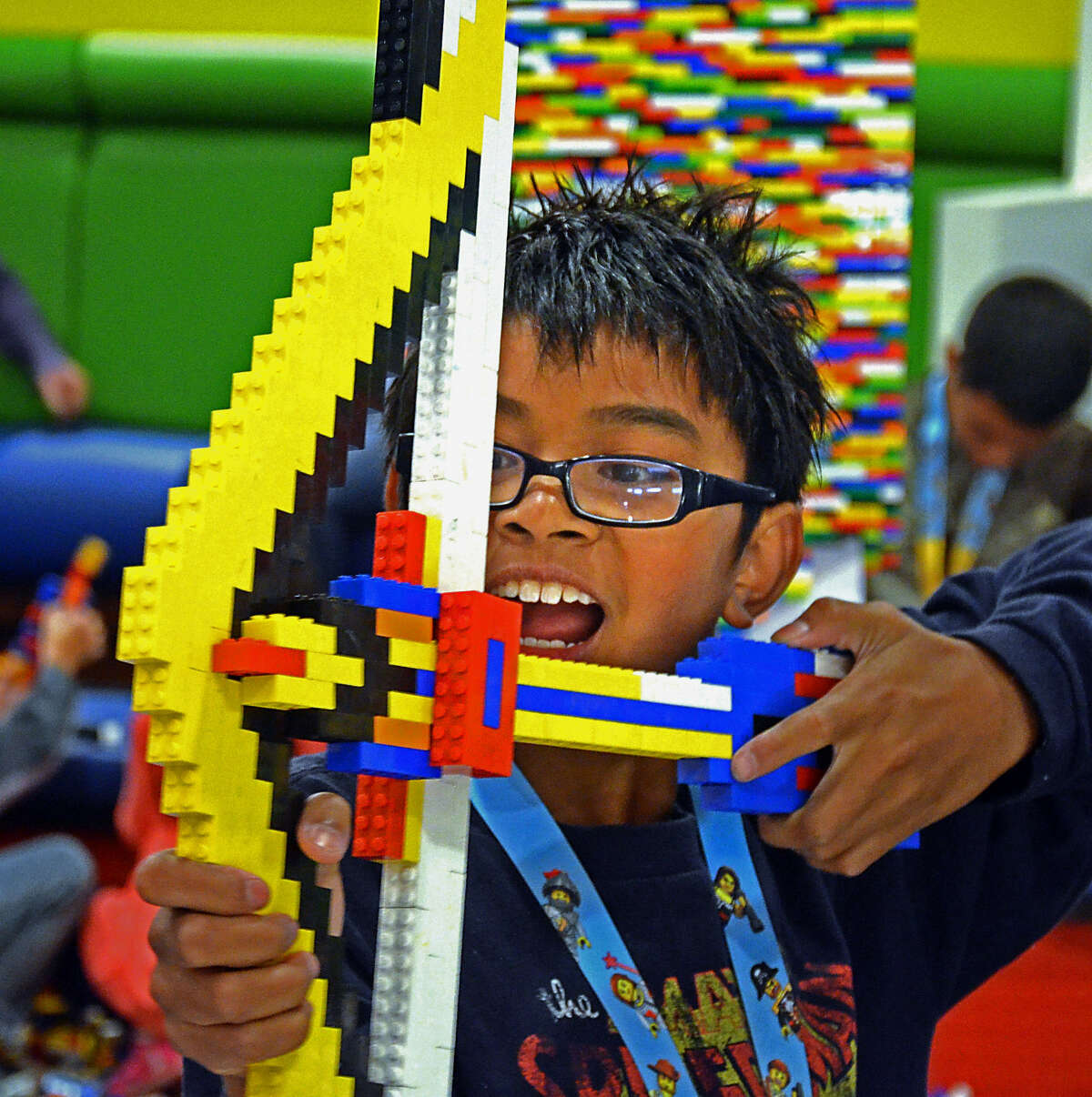 Mason Eugenio, 11, plays with a bow he made from Lego pieces. Legos are the No. 1 toy sought by boys.