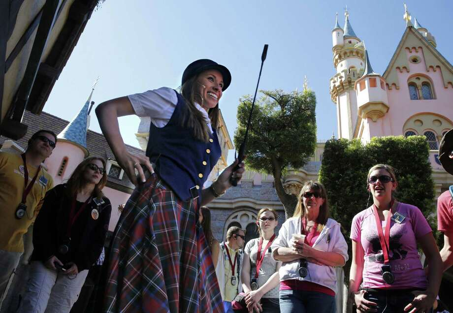 Victoria Dale takes visitors on a $109 tour — A Walk in Walt's Disneyland Footsteps — at Disneyland in Anaheim, Calif. Photo: McClatchy-Tribune News Service