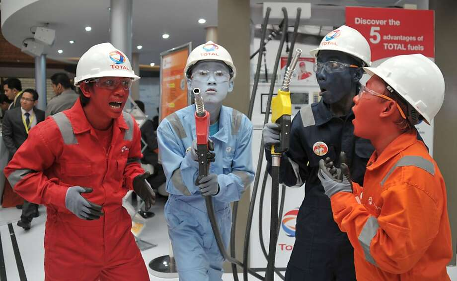 Why didn't the Village People think of this? Performers dressed in oil driller outfits pose during the 37th Indonesian Petroleum Association convention and exhibition in Jakarta.  Photo: Bay Ismoyo, AFP/Getty Images