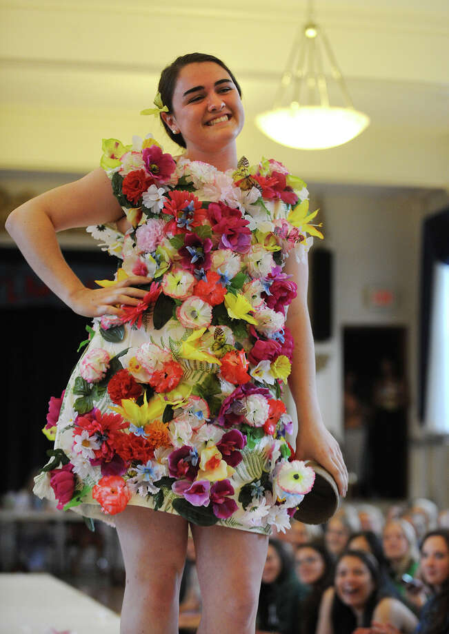 Lauralton Hall student Caroline McCauley models a dress she created with plastic flowers at the annual Eco Fashion Show put on by the Environmental Club at Lauralton Hall in Milford, Conn. on Thursday, May 16, 2013. Photo: Brian A. Pounds / Connecticut Post