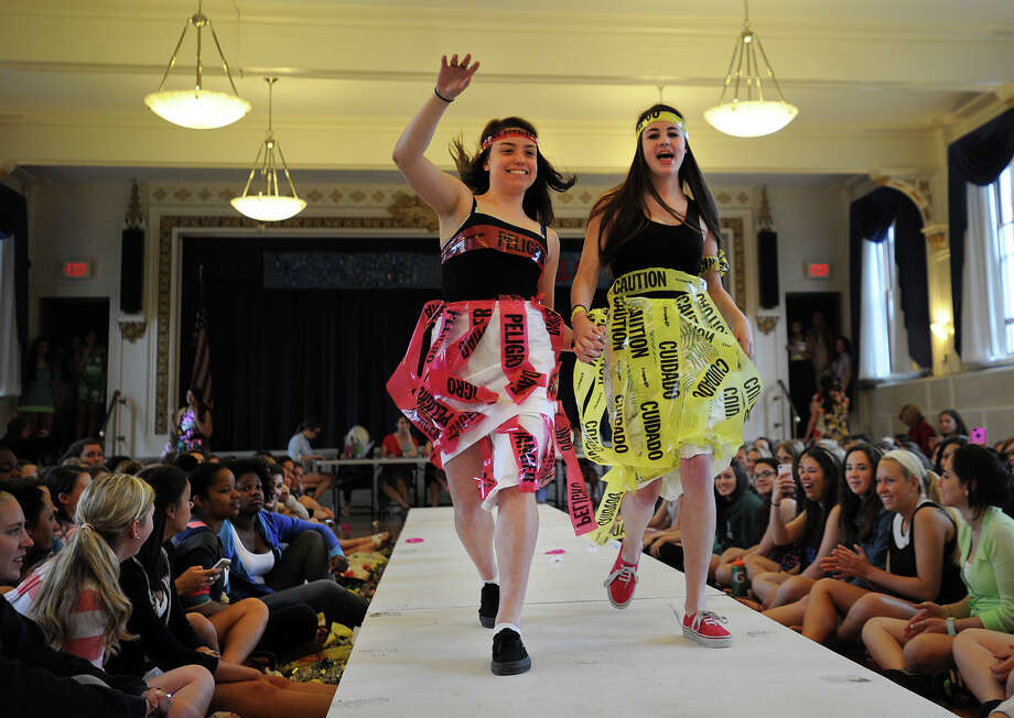 Lauralton Hall students Audrey O'Donnell and Autumn Katz model their recycled creations at the Environmental Club's annual Eco Fashion Show at Lauralton Hall in Milford, Conn. on Thursday, May 16, 2013. Photo: Brian A. Pounds / Connecticut Post