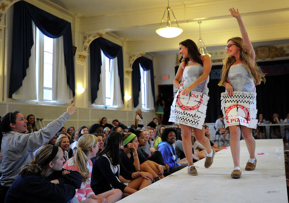 Lauralton Hall students Bella Giannini and Kenzie Tavella model skirts made from pizza boxes at the Environmental Club's annual Eco Fashion Show at Lauralton Hall in Milford, Conn. on Thursday, May 16, 2013. Photo: Brian A. Pounds / Connecticut Post
