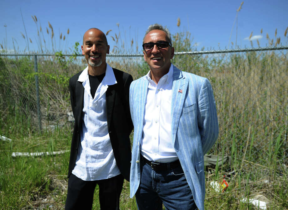 Sean Richardson, left, and Antonio St. Lorenzo, of Heroes Village, LLC, are planning the construction of a hydroponic greenhouse, retail space, and a community center, at the old Mount Trashmore site on Central Avenue in Bridgeport's East End. Photo: Brian A. Pounds / Connecticut Post
