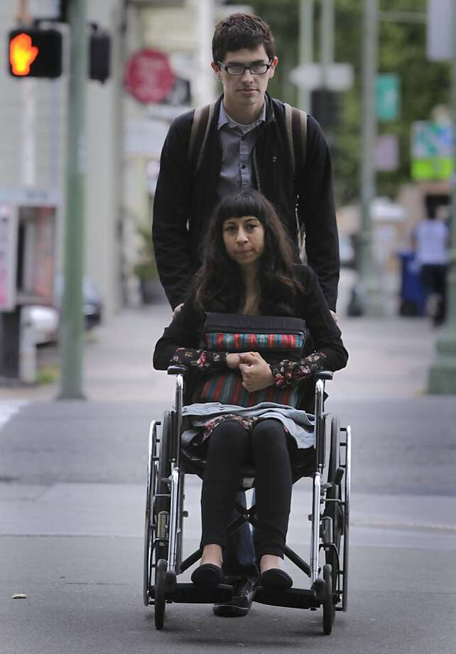 Eli Reyes arrives at the Wiley W. Manuel Courthouse with her boyfriend Ivan Navarro to attend a preliminary hearing in Oakland, Calif. on Thursday, May 16, 2013. Reyes is still recovering from injuries from a hit-and-run driver back in April. Photo: Paul Chinn, The Chronicle