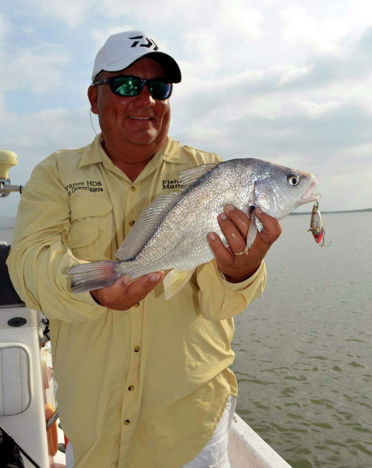 Catching a nice two-pound gaspergou during an angling adventure for largemouth and white bass at Choke Canyon Reservoir is considered a bonus by Guide Manny Martinez as he takes advantage of a mixed bag of fishing fun on the lake.