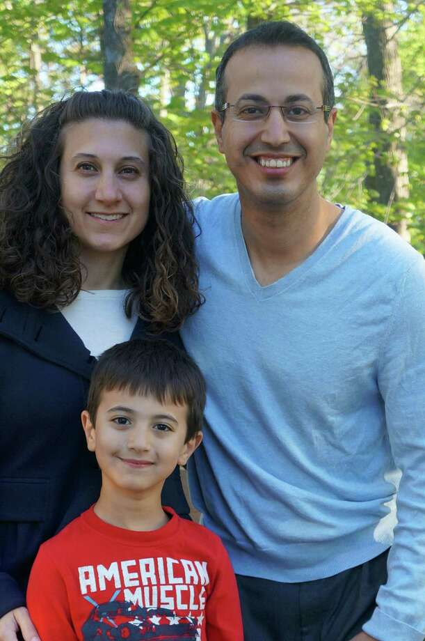 Zane Abdelsadek, 6, with his parents, Nancy Mahmoud and Mohamed Abdelsadek, has a rare allergic inflammatory disease that forces him to take in most of his nutrition through a gastrostomy tube. WESTPORT NEWS, CT 5/13/13. Photo: Paul Schott / Westport News