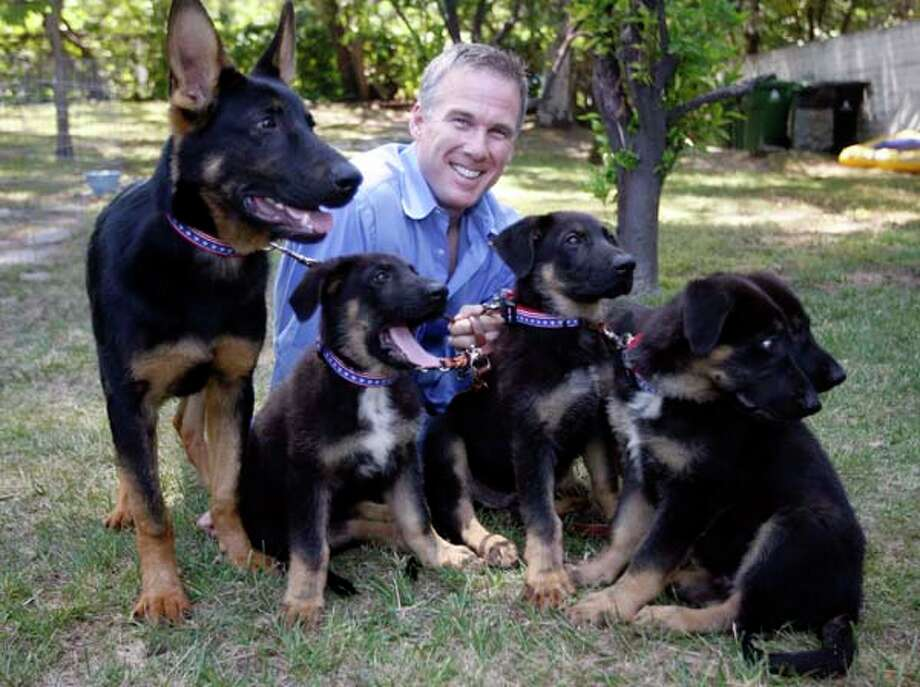 James Symington poses with five puppies cloned from a German shepherd that reportedly took part in the search-and-rescue effort after the 9/11 terrorist attacks. Photo: Damian Dovarganes, AP / AP