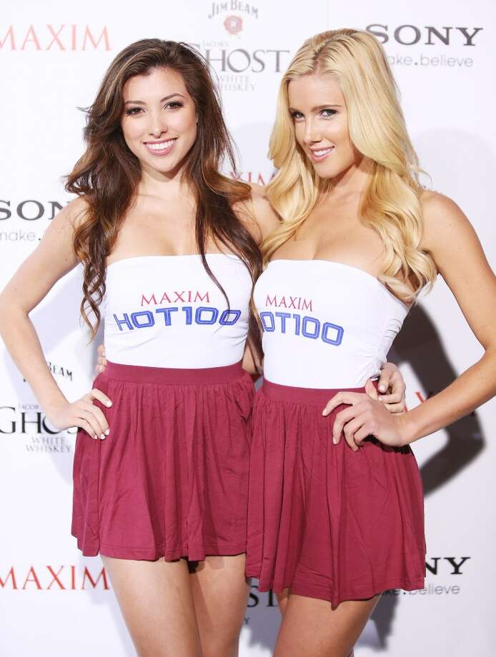 HOLLYWOOD, CA - MAY 15:  Maxim Hot 100 girls wait to greet arriving guests at the Maxim 2013 Hot 100 Party held at Create on May 15, 2013 in Hollywood, California.  (Photo by Michael Tran/FilmMagic)