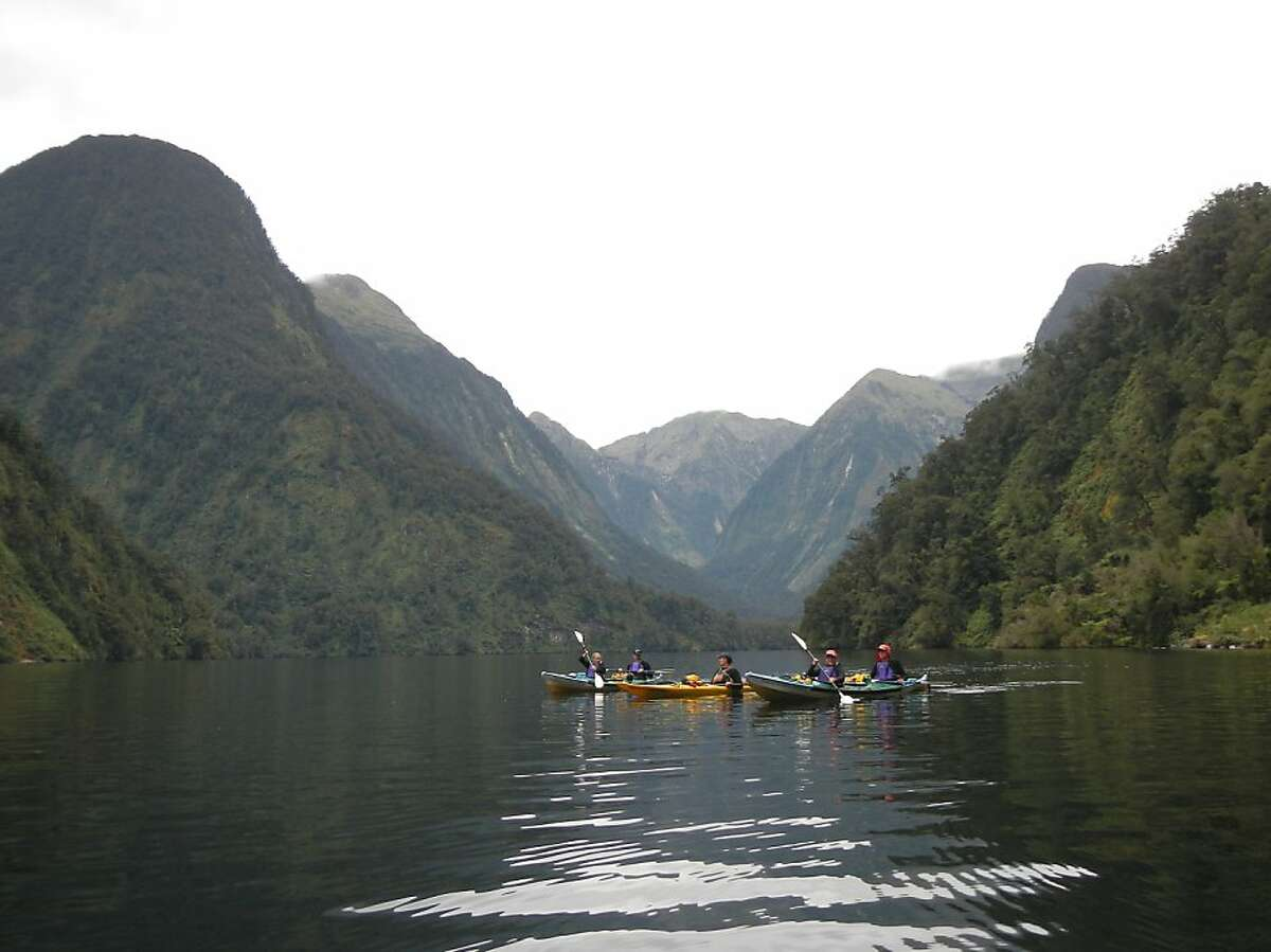 Kayakers on an overnight tour around Doubtful Sound on New Zealand's south island.