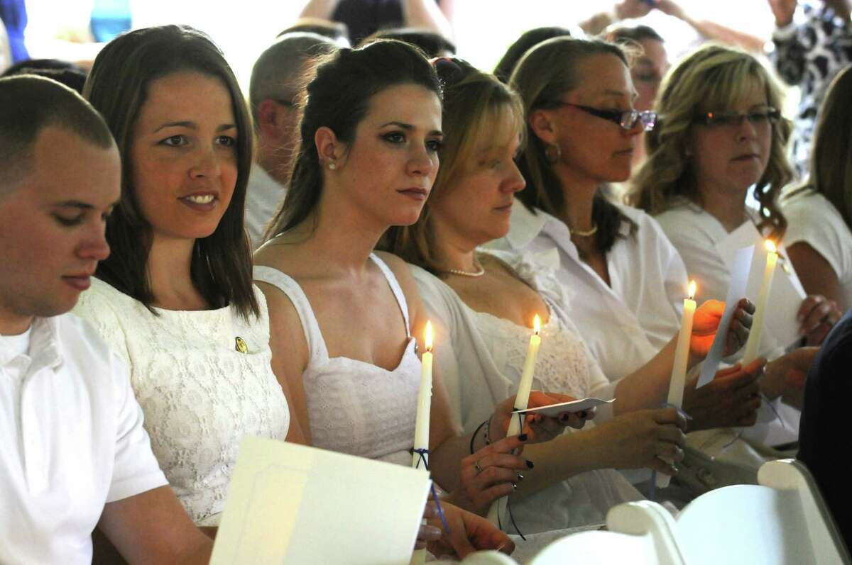 Graduates prepare to read the Florence Nightingale Pledge during the Maria College Annual White Tea Ceremony honoring senior nursing graduates in a candlelight ceremony on Thursday May 16, 2013 in Albany, N.Y. The college commencement is Sunday. (Michael P. Farrell/Times Union)