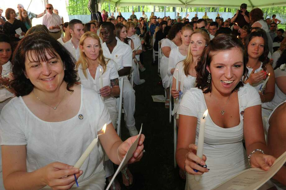 Graduates Amanda Benacquisto, left, and Cathy Barry read the Florence Nightingale Pledge during the Maria College Annual White Tea Ceremony honoring senior nursing graduates in a candlelight ceremony on Thursday May 16, 2013 in Albany, N.Y.  The college commencement is Sunday. (Michael P. Farrell/Times Union) Photo: Michael P. Farrell