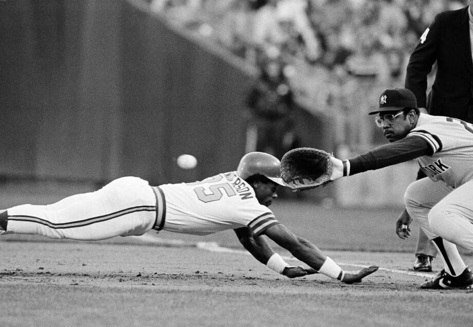 Rickey Henderson dives head-long into first base to avoid a pickoff in the first inning on Thursday, Oct. 15, 1981 in Oakland in the third game of the American League playoffs.