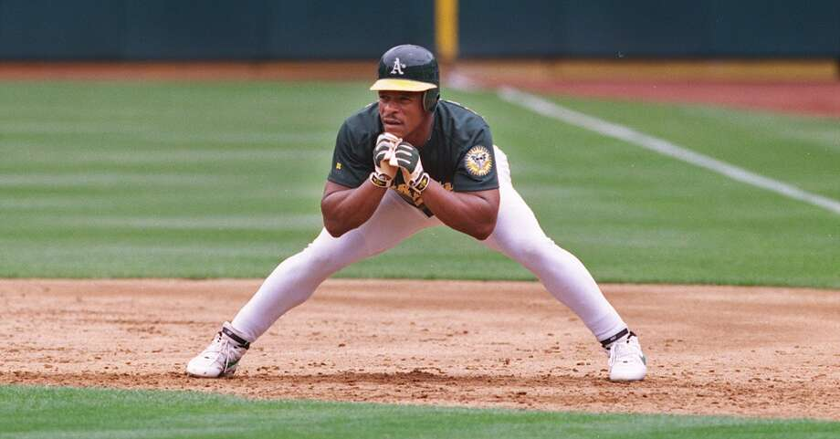 Oakland A's Rickey Henderson, takes his signature lead off at first base.