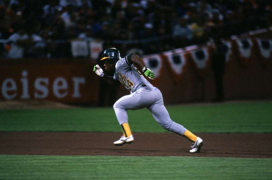 Rickey Henderson sprints on the basepaths during the 1989 World Series against the San Francisco Gaints at Candlestick Park in San Francisco, California.