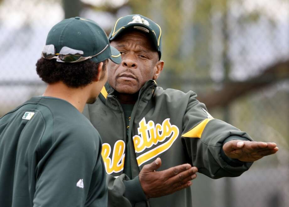Rickey Henderson talks to Coco Crisp about his slide on Saturday February 27, 2010 at spring training.