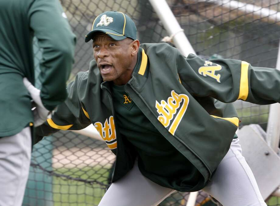 Former Oakland Athletics star Rickey Henderson gives out pointers to current players.