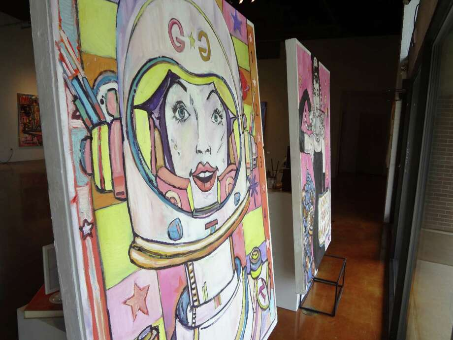 "Rex Hausmann's paintings ""Galaxy Gal"" (left) and ""Simply Fab-u-LS Daalng"" face out the front windows of Gallery Nord. Photo: Photos By Steve Bennett / San Antonio Express-News"