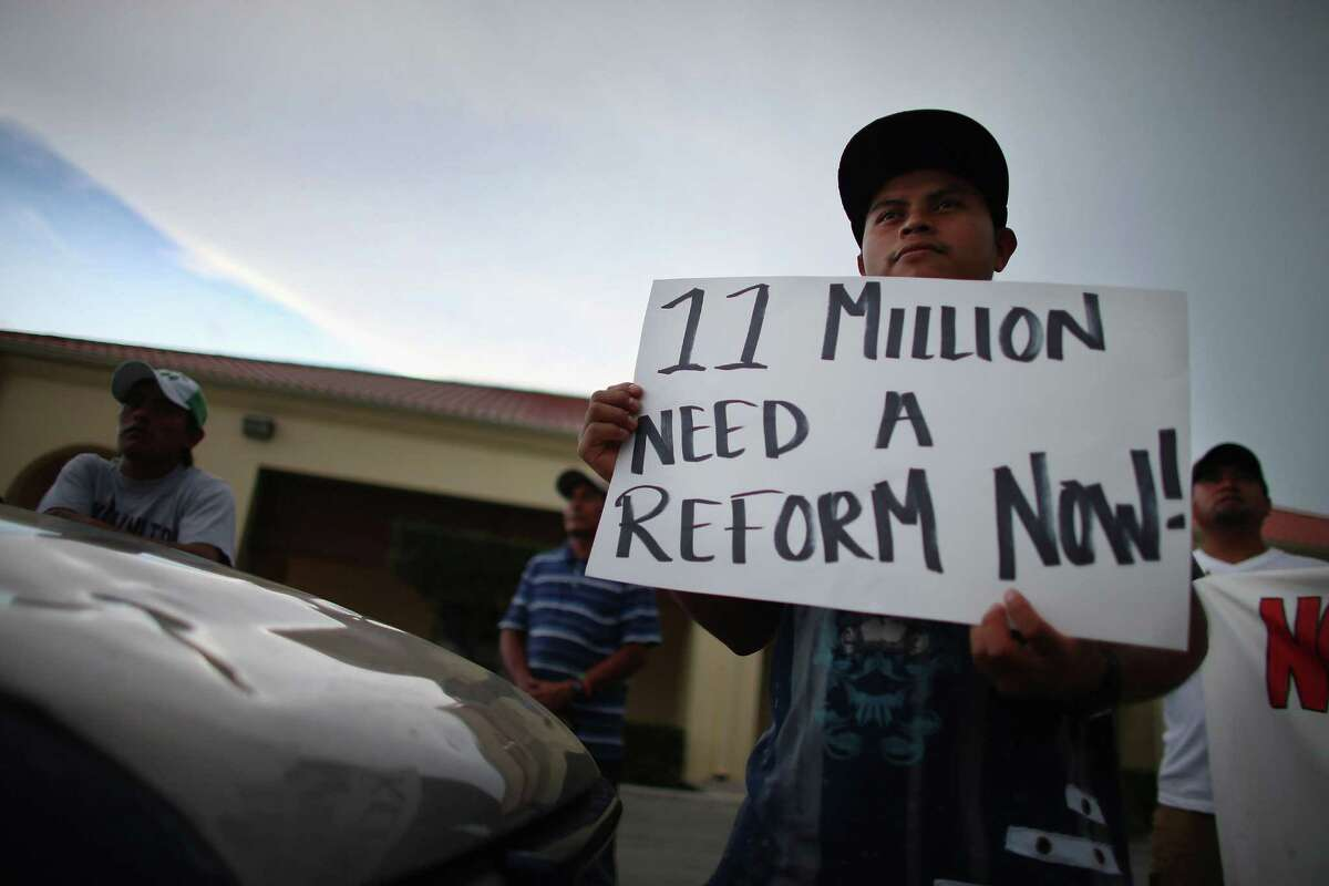 Protesters in Homestead, Fla., call for Congress to pass immigration reform.