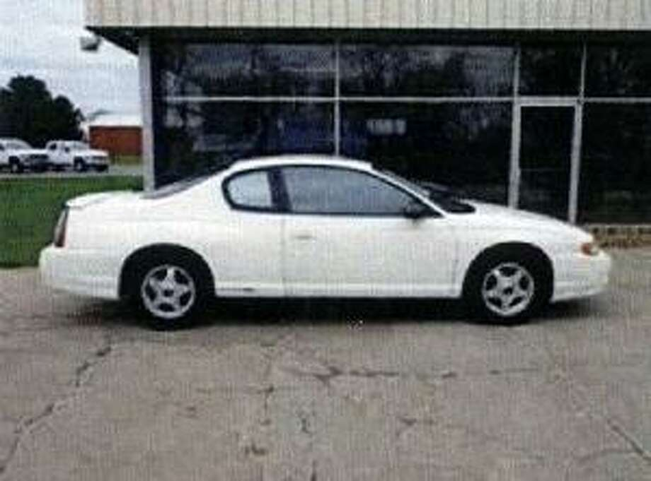 A light colored or silver Chevrolet Monte Carlo, similar to the one pictured here, was possibly used by gunmen who killed a woman and 10-year-old boy in a shooting in Alief.