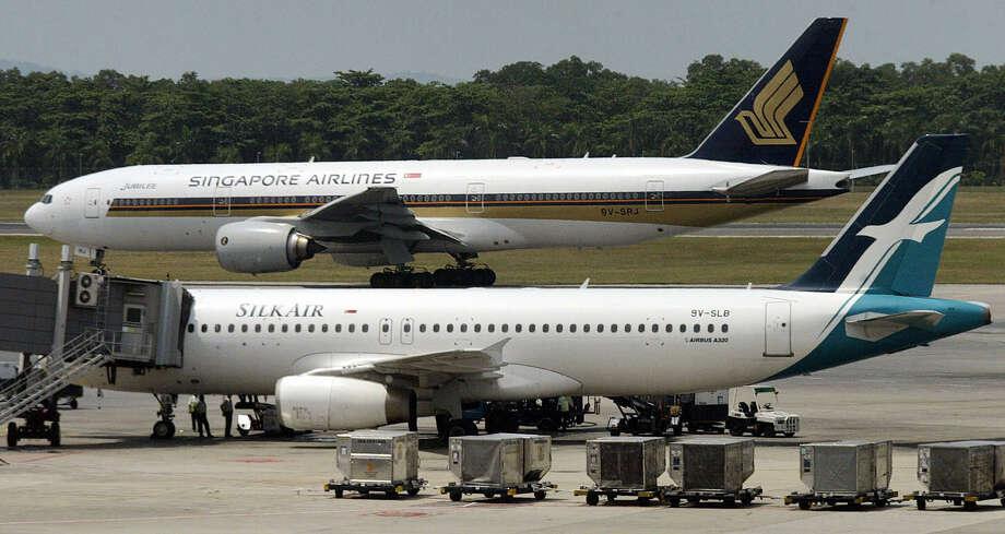 Speaking of subsidiaries, SilkAir is one to Singapore Airlines. Photo: ROSLAN RAHMAN, AFP/Getty Images / 2003 AFP