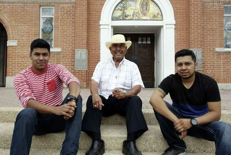 Miguel Aguilar Jr. (from left), Genaro Aguilar and Ricardo Medina Jr. in front of Our Lady of Guadalupe Catholic Church, where Genaro Aguilar's Grupo Guadalupano was formed more than 60 years ago. The younger men carry on the family tradition. Photo: Helen L. Montoya / San Antonio Express-News