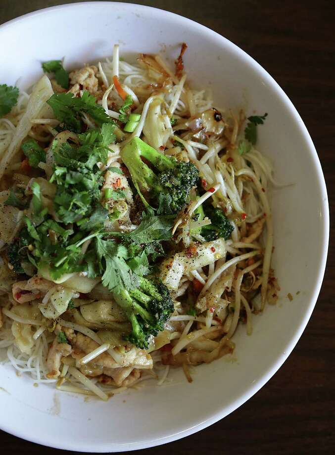 Among the good choices of vermicelli bowls, this one includes shrimp, chicken and grilled pork. Photo: Photos By Bob Owen / San Antonio Express-News