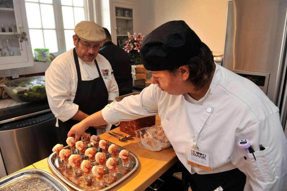 "Sam Salazar and Aneyra Littlefield of Catalyst Catering prepare Ceviche Shrimp Shooters for the ""Great Gatsby"" party. Photo: Photos By Robin Jerstad / For The Express-News"