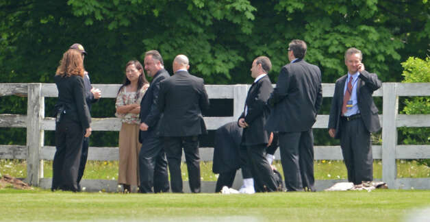 Police interview Wen Qi, third from left, a 36-year-old from Toronto, who they say was trying to sneak into Prince Harry s charity fundraiser at the Greenwich Polo Club in Greenwich, Conn., on Wednesday, May 15, 2013. Photo: John Ferris Robben