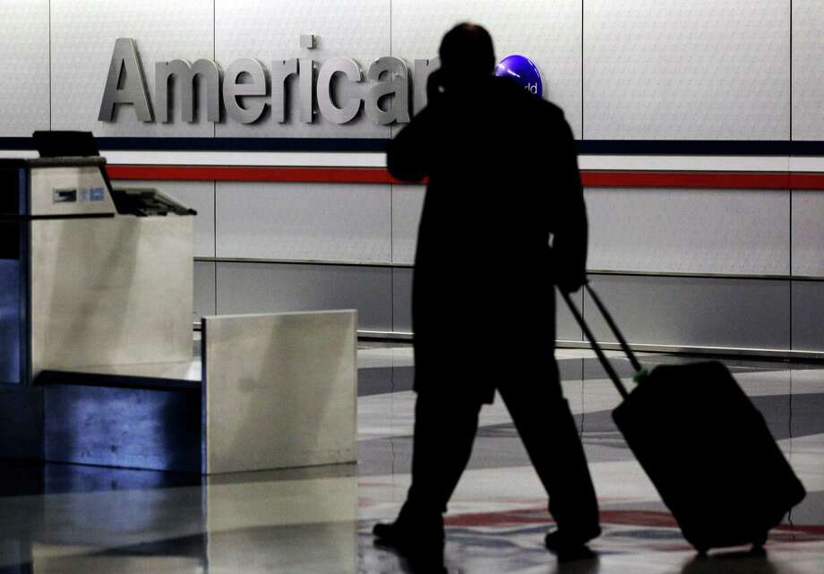 American Airlines says people carrying just a personal item that fits under the seat — no rolling suitcases such as this one — will be allowed to board before most other passengers. Photo: Associated Press File Photo