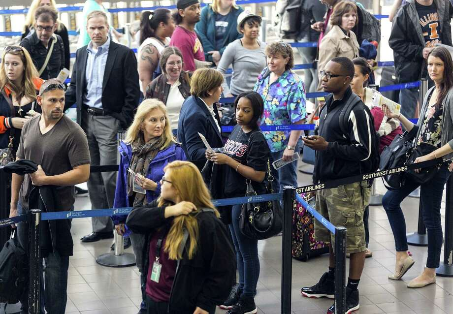 Travelers stand in line last month at Los Angeles International Airport. A summer travel forecast bodes well for airlines, as more people are expected to fly, , an industry group said. Photo: Associated Press