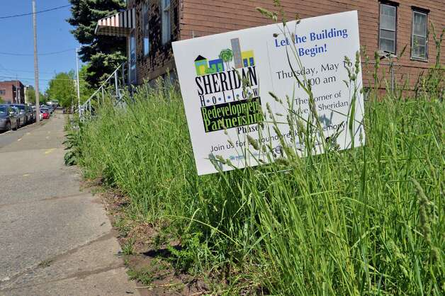 Sign along a stretch of Sheridan Ave. to become Habitat for Humanity Capital District's Sheridan Hollow Redevelopment  Partnership NY Thursday May 16, 2013.   (John Carl D'Annibale / Times Union) Photo: John Carl D'Annibale / 00022432A