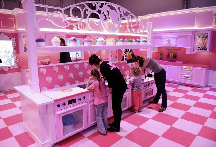 The pink kitchen is pictured with cupcakes in the Barbie Dreamhouse Experience near Alexanderplatz square  in Berlin, Germany, Thursday May 16,  2013. The 2,500 square meter Barbie Dreamhouse Experience will be open for three months in Berlin.  (AP Photo/dpa, Jens Kalaene) Photo: Jens Kalaene