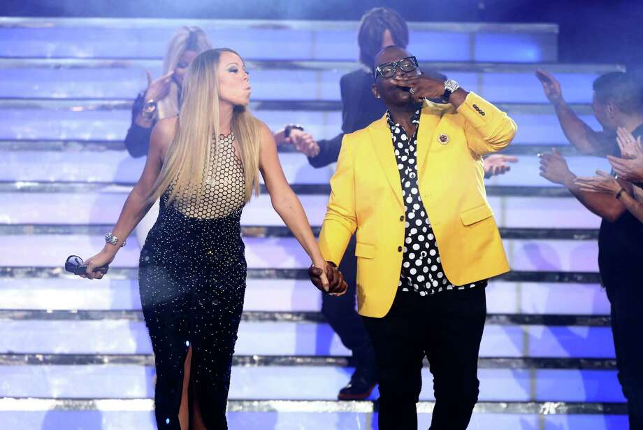 "Judges Mariah Carey, left, and Randy Jackson walk on stage at the ""American Idol"" finale at the Nokia Theatre at L.A. Live on Thursday, May 16, 2013, in Los Angeles. (Photo by Matt Sayles/Invision/AP) Photo: Matt Sayles, INVL / Invision"